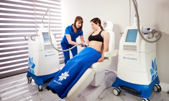 CoolSculpting Expert administering procedure to patient